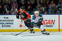 KELOWNA, CANADA - JANUARY 30: Kristians Rubins #5 of the Medicine Hat Tigers back checks Leif Mattson #28 of the Kelowna Rockets on January 30, 2017 at Prospera Place in Kelowna, British Columbia, Canada.  (Photo by Marissa Baecker/Shoot the Breeze)  *** Local Caption ***
