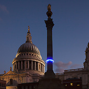 Plunge project by Arts Admin and artist Michael Pinsky. The monument in Paternoster Square has been fitted with a ring of blue light at 28m above sea levels to indicate where the sea levels will be in 1000 years time if we, the human race, continue our CO2 emmissions at current rate. An estimated hight of raised seal levels will be 28m, based on current available science. 3 monuments in London have been fitted with a ring of light at 28 m above sea levels, one is on the Duke of York Monument, another the monument in Paternoster Square and the third on the monument in Sevel Dials in Covent Garden.