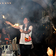 A lady ignites sparklers after everyone sings happy birthday. (photo by Lia Latty).