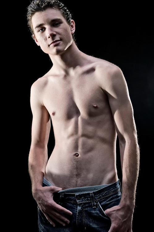Portrait of attractive young man, posing shirtless showing muscular build.