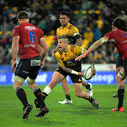 TJ Perenara passes during the Super Rugby final match between the Hurricanes and Lions at Westpac Stadium, Wellington, New Zealand on Saturday, 6 August 2016. Photo: Dave Lintott / lintottphoto.co.nz