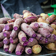 Purple sweet potato at market stall in Saigon