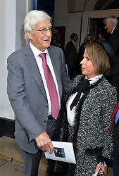 Journalist and television presenter Alan Whicker's memorial service at Grosvenor Chapel, Mayfair, London, UK.<br /> <br /> Pictured are Michael Parkinson and Valerie Kleeman (Alan Whicker's partner)<br /> <br /> Wednesday, 28th May 2014. Picture by Ben Stevens / i-Images