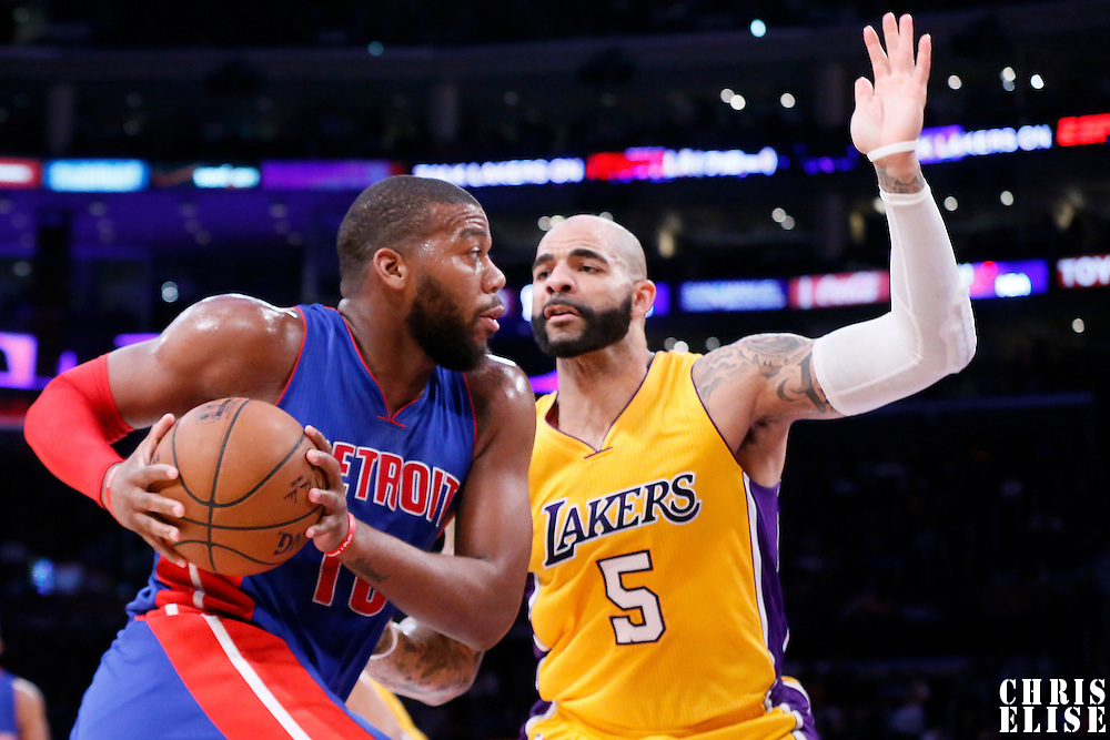 10 March 2015: Detroit Pistons forward Greg Monroe (10) drives past Los Angeles Lakers forward Carlos Boozer (5) during the Los Angeles Lakers 93-85 victory over the Detroit Pistons, at the Staples Center, Los Angeles, California, USA.