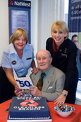 Natwest Bank Gleadless branch 50th Birthday 15th October 2010 .Banks oldest customer 96 year old Douglas Higgins with NatWest Customer  Service Officer Pam Bartrop and Manager Alison Hobson.Images © Paul David Drabble