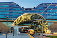 The train station at Denver International Airport, Denver, Colorado USA. The RTD Train to the Plane connects the airport with Denver Union Station in Downtown Denver. Westin DIA Hotel in background.
