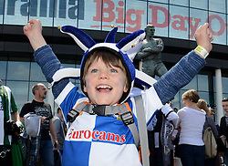 A young Bristol Rovers fan cheers outside Wembley Stadium before the Vanarama Conference Play-Off Final - Photo mandatory by-line: Dougie Allward/JMP - Mobile: 07966 386802 - 17/05/2015 - SPORT - football - London - Wembley Stadium - Bristol Rovers v Grimsby Town - Vanarama Conference Football