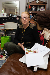Widow Ann Anderson who had her partially toothless little Yorkshire Terrier Albert 'arrested' by the police after it was alleged her dog had attacked a post office worker, reads letters of support from neighbours and friends who know both her and Albert. London, September 10 2018.