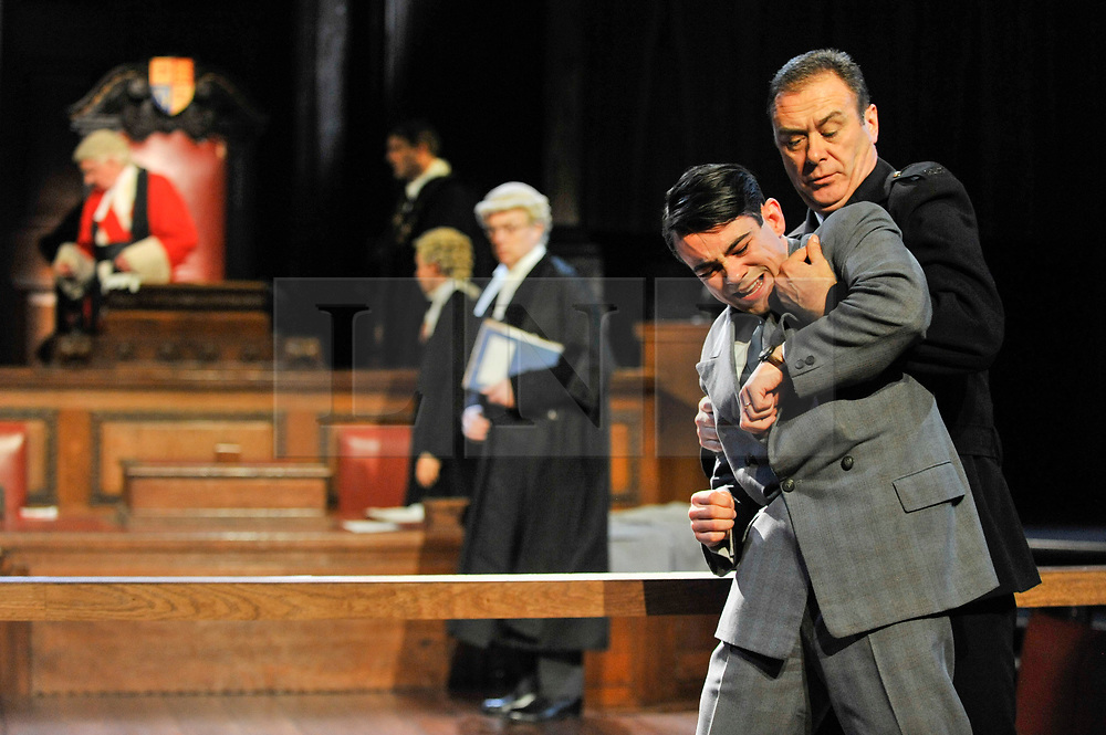 "© Licensed to London News Pictures. 20/10/2017. London, UK. Jack McMullen as Leonard Vole, the accused is restrained by John House as the Warder.  Photocall for ""Witness for the Prosecution"", by Agatha Christie, directed by Lucy Bailey, at London County Hall.  The play opens 23 October. Photo credit : Stephen Chung/LNP"