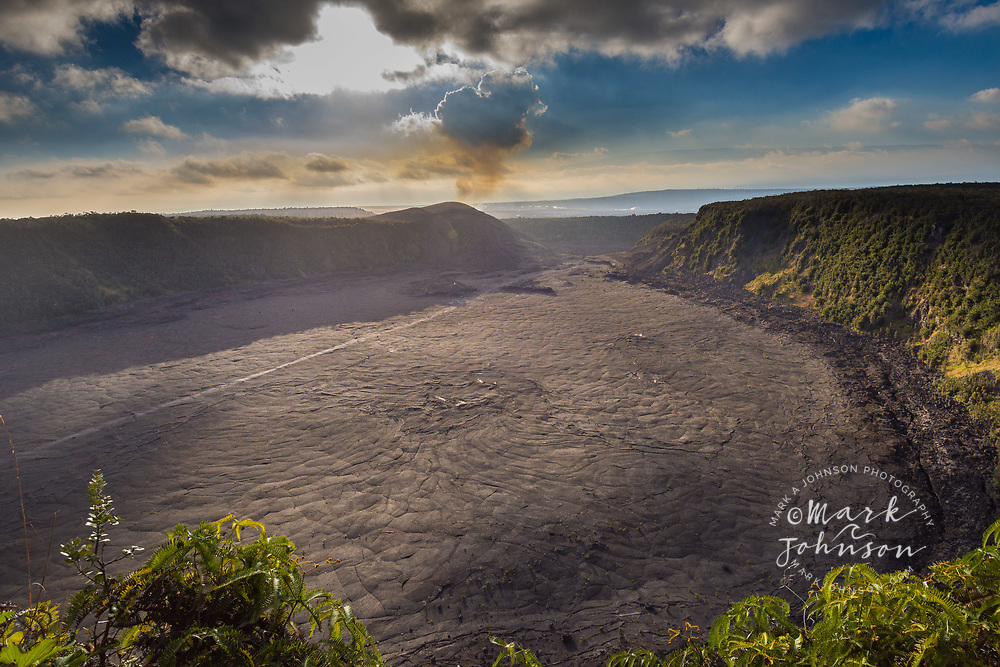 Kilauea Iki Crater, with smoke from the eruption inside Halemaumaum Crater in background, Hawaii Volcanoes National Park, Big Island, Hawaii