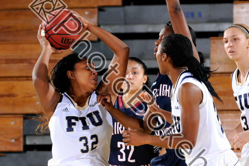 2013 December 28 - FIU's Tynia McKinzie (32). Florida International University defeated Fairleigh Dickinson, 79-57, at US Century Bank Arena, Miami, Florida. (Photo by: Alex J. Hernandez / photobokeh.com) This image is copyright by PhotoBokeh.com and may not be reproduced or retransmitted without express written consent of PhotoBokeh.com. ©2013 PhotoBokeh.com - All Rights Reserved