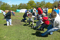 Scouts playing tug o war on a camping weekend