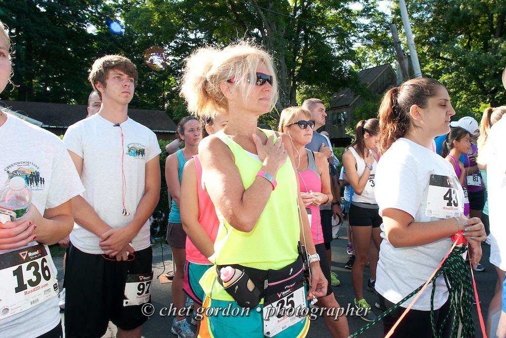 Runners listen to the National Anthem prior to the Greenwood Lake Inaugural 5K Run in Greenwood Lake, NY on Saturday, August 9, 2014.  © Chet Gordon/THE IMAGE WORKS