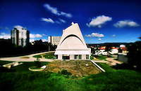 Saint Peter is a concrete building in the commune of Firminy, France. The last major work of French Swiss-born architect Le Corbusier, it was completed in 2006, 41 years after his death.<br /> Designed to be a church in the model city of Firminy Vert, the construction of Saint-Pierre was begun in 1971, six years after Le Corbusier's death in 1965. Due to local political conflicts it remained stalled from 1975 to 2003, when the local government declared the mouldering concrete ruin an &quot;architectural heritage&quot; and financed its completion. It has been used for many different purposes, as a secondary school and as a shelter. As the laicist French state may not use public funds for religious buildings, Saint-Pierre is now used as a cultural venue.<br /> The building was completed by French architect Jos&eacute; Oubrerie, Le Corbusier's student for many years.<br /> <br /> L'&eacute;glise Saint-Pierre de Firminy est une &eacute;glise catholique situ&eacute;e &agrave; Firminy dans la Loire en France.<br /> Cette &eacute;glise est un b&acirc;timent en b&eacute;ton situ&eacute; dans la commune de Firminy, c'est un des derniers projets de l'architecte Le Corbusier. Le Corbusier l'a con&ccedil;u pour &ecirc;tre une &eacute;glise dans la ville mod&egrave;le de Firminy Vert, voulue en 1953 par l'ancien maire Eug&egrave;ne Claudius-Petit qui fut ministre de la Reconstruction et de l'urbanisme. La construction de Saint-Pierre a commenc&eacute; en 1970, cinq ans apr&egrave;s la mort de Le Corbusier. Elle a &eacute;t&eacute; achev&eacute;e 41 ans apr&egrave;s sa mort le 26 novembre 2006. Cependant, le b&acirc;timent n'est pas officiellement une &eacute;glise ; il sert surtout &agrave; t&eacute;moigner de l'oeuvre architecturale de Le Corbusier.