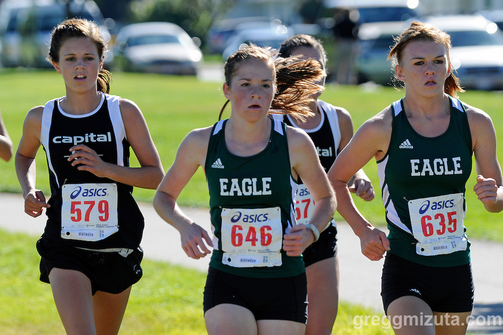 Savana Schilling, Brooke Rawlins, and Sabrina Coles during the NNU Invite girl's varsity race at West Park in Nampa, ID on September 11, 2010.<br /> <br /> Schilling finished in 20:28.40 (13th),  Rawlins in 20:49.50 (15th), and Coles in 21:13.40 (19th).