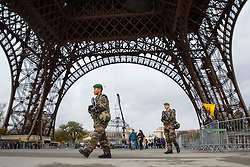 © Licensed to London News Pictures. 17/11/2015. Paris, France. French soldiers patrolling the Eiffel Tower in Paris, France following the Paris terror attacks on Tuesday, 17 November 2015. Photo credit: Tolga Akmen/LNP
