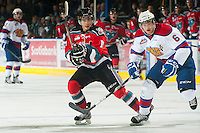KELOWNA, CANADA - NOVEMBER 7:  Filip Vasko #10 of the Kelowna Rockets is checked by David Musil #6 of the  Edmonton Oil Kings at the Kelowna Rockets on November 7, 2012 at Prospera Place in Kelowna, British Columbia, Canada (Photo by Marissa Baecker/Shoot the Breeze) *** Local Caption ***