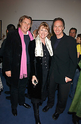 Left to right, THEO & LOUISE FENNELL and NICK EVANS at a concert by Charlotte Gordon Cumming in aid of Tusk held at the National Geographical Society, 1 Kensington Gore, London SW7 on 16th March 2006.<br /><br />NON EXCLUSIVE - WORLD RIGHTS