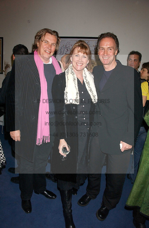 Left to right, THEO &amp; LOUISE FENNELL and NICK EVANS at a concert by Charlotte Gordon Cumming in aid of Tusk held at the National Geographical Society, 1 Kensington Gore, London SW7 on 16th March 2006.<br /><br />NON EXCLUSIVE - WORLD RIGHTS