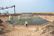 wind turbine base construction filling in concrete