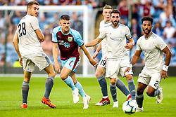 Johann Gudmundsson of Burnley takes on Tommie Hoban, Lewis Ferguson, Graeme Shinnie and Shaleum Logan of Aberdeen - Mandatory by-line: Robbie Stephenson/JMP - 02/08/2018 - FOOTBALL - Turf Moor - Burnley, England - Burnley v Aberdeen - UEFA Europa League Second Qualifier, 2nd Leg