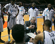 Head Coach Robert Spon speaks with players during a timeout at the Razorsharks opener at the Blue Cross Arena on Saturday, December 6, 2014.