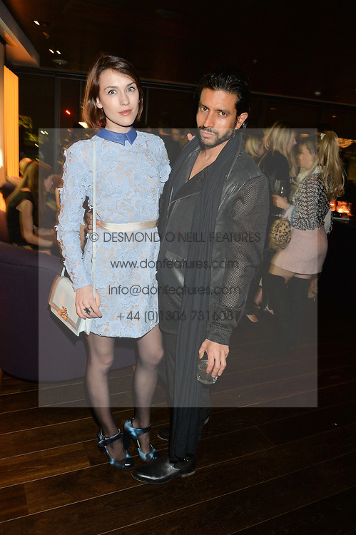 ELLA CATLIFF and NIK THAKKAR at the Launch Of Osman Yousefzada's 'The Collective' 4th edition with special guest collaborator Poppy Delevingne held in the Rumpus Room at The Mondrian Hotel, 19 Upper Ground, London SE1 on 24th November 2014, sponsored by Storm models and Beluga vodka.
