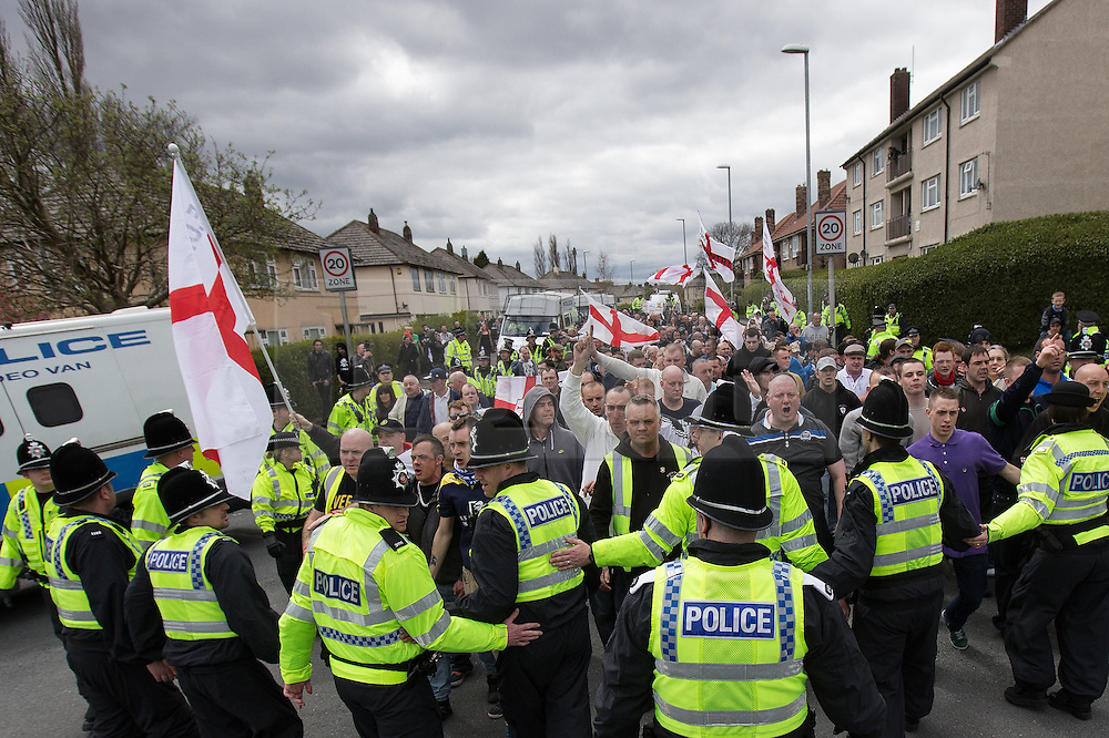 © Licensed to London News Pictures . 04/05/2013 . Leeds , UK . The English Defence League hold a demonstration in the Moortown housing estate in Leeds over plans to convert a disused pub in to an Islamic Centre . This is the first EDL demonstration in the region since six men were convicted of planning a terrorist attack on an EDL demonstration in Dewsbury . Photo credit : Joel Goodman/LNP