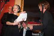 KAREN DUFFY COLLECTS THE 2012 BAD SEX AWARD ON BEHALF OF WRITER NANCY HUSTON FROM SAMANTHA BOND, The Literary Review Bad Sex fiction award 2012. The In and Out Club, 4 St. james's Sq. London. 4 December 2012