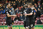 Michael Jacobs of Wigan Athletic  celebrates scoring with Andy Kellett of Wigan Athletic to go 1 all during the Sky Bet League 1 match between Scunthorpe United and Wigan Athletic at Glanford Park, Scunthorpe, England on 2 January 2016. Photo by Ian Lyall.