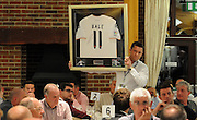 A signed Gareth Bale shirts is one of the many items up for grabs in the auction during the Julian Speroni Testimonial Golf Day at the Surrey National Golf Club, Chaldon, United Kingdom on 9 September 2015. Photo by Michael Hulf.