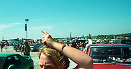 "Copyright ©Ê2004 Jeremy Hogan - All Rights Reserved..A deadhead tries to get a ""Miracle Ticket"" for the Furthur Fest show in Bonner Springs, Kansas during July 1996. ..Generation x, genx, grateful dead, deadhead, deadheads, dropout, hippy, hipster, hip, traveler, youth culture, journey, Americana, 90s, 1990s, counterculture, Miracle Ticket, blue sky, vertical, panoramic"