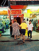 Elderly western couple visit a go-go bar.