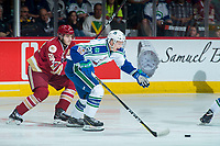 REGINA, SK - MAY 19: Noah Dobson #53 of Acadie-Bathurst Titan back checks Aleksi Heponiemi #20 of Swift Current Broncos as he skates for the puck at the Brandt Centre on May 19, 2018 in Regina, Canada. (Photo by Marissa Baecker/CHL Images)