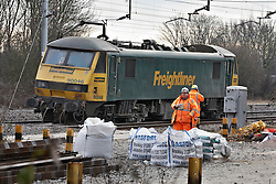 © Licensed to London News Pictures.  03/02/2012. BLETCHLEY, UK . A derailed freight train is blocking the West Coast Main Line near Bletchley station in Buckinghamshire after coming off the tracks early this morning (Fri). Network rail hopes to partially reopen the line this afternoon and begin easing the massive dealys passengers are experiencing. The cause of the derailment  is being investigated but may be related to the bitterly cold overnight weather.  Photo credit: Cliff Hide/LNP