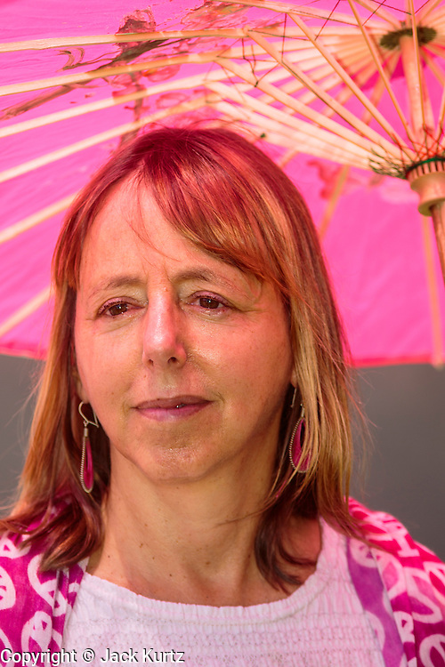 """31 JULY 2012 - PHOENIX, AZ:  MEDEA BENJAMIN waits to speak at a press conference at the Arizona State Capitol Tuesday. Medea is a political activist, best known for co-founding Code Pink and, along with her husband, activist and author Kevin Danaher, the fair trade advocacy group Global Exchange. She was also a Green Party candidate in 2000 for the United States Senate. She appeared in Phoenix to promote her new book, """"Drone Warfare: Killing by Remote Control."""" She, and other members of Code Pink, presented a letter to Arizona Gov. Jan Brewer protesting Brewer's request to use the state's airspace to train drone pilots.  PHOTO BY JACK KURTZ"""