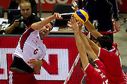 Bartosz Kurek from Poland spikes during the 2013 CEV VELUX Volleyball European Championship match between Poland and Turkey at Ergo Arena in Gdansk on September 20, 2013.<br /> <br /> Poland, Gdansk, September 20, 2013<br /> <br /> Picture also available in RAW (NEF) or TIFF format on special request.<br /> <br /> For editorial use only. Any commercial or promotional use requires permission.<br /> <br /> Mandatory credit:<br /> Photo by &copy; Adam Nurkiewicz / Mediasport