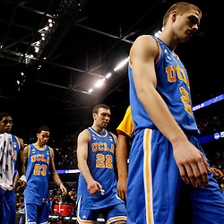 Mar 19, 2011; Tampa, FL, USA; UCLA Bruins players walk off the court following a loss to the Florida Gatorsin the third round of the 2011 NCAA men's basketball tournament at the St. Pete Times Forum. Florida defeated UCLA 73-65.  Mandatory Credit: Derick E. Hingle