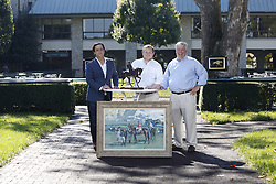 Cross Gate Gallery team that curated the Sporting Art Auction owner Greg Ladd, Fields Ladd, and Bill , Friday, Sept. 23, 2016 at Keeneland Paddock in Lexington .