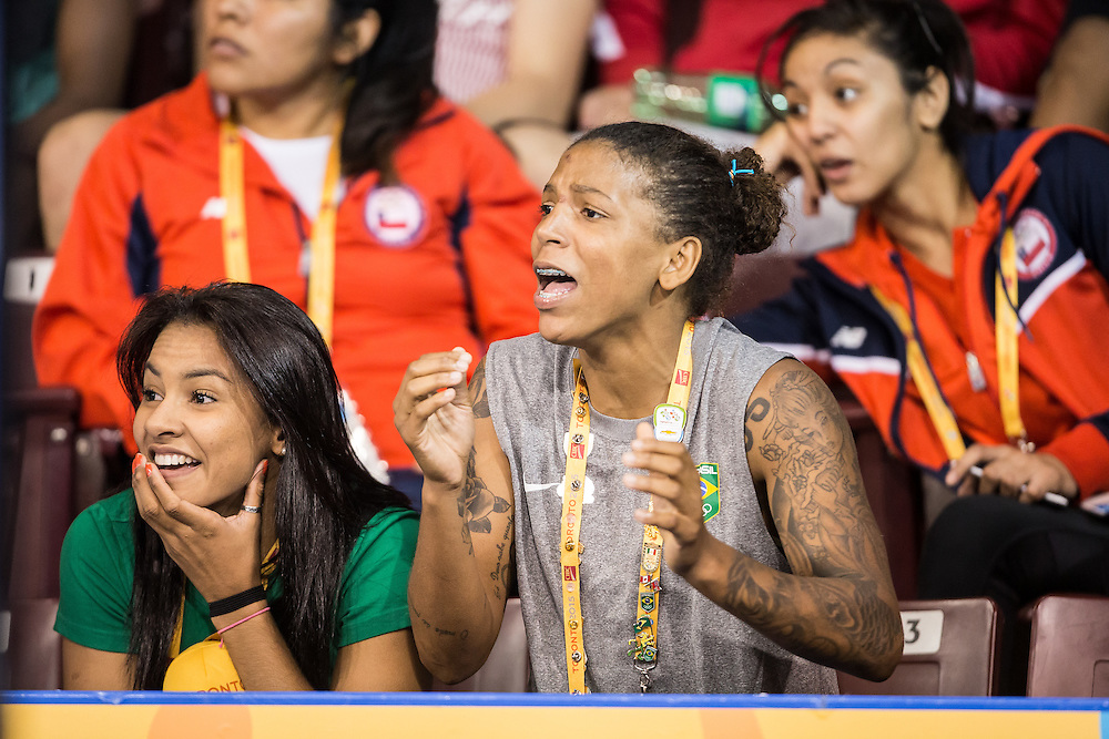 Brazil's Rafaela Silva (R) winner of the bronze medal in the women's judo 57kg class lat evening cheers on her teammates at the 2015 Pan American Games in Toronto, Canada, July 13,  2015.  AFP PHOTO/GEOFF ROBINS
