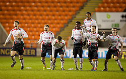 BLACKPOOL, ENGLAND - Wednesday, December 18, 2013: Liverpool players celebrate as they beat Blackpool after a penalty shoot-out (4-3) during the FA Youth Cup 3rd Round match at Bloomfield Road. L-R: Jordan Williams, captain Conor Randall, Sergi Canos, Sheyi Ojo, Jerome Sinclair, Harry Wilson, Jordan Rossiter. (Pic by David Rawcliffe/Propaganda)
