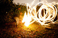 My friend nick whirling around a stick lit on fire with white gas for a long exposure.
