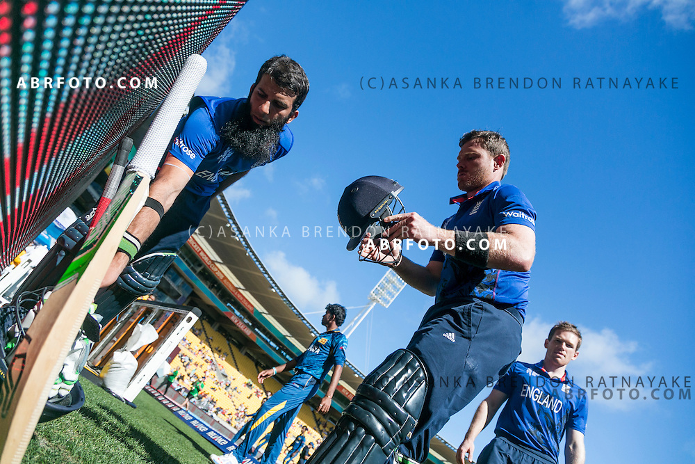 Ian Bell and Moeen Ali grab their equipment before headnig out to bat during the 2015 ICC Cricket World Cup Pool A group match between England Vs Sri Lanka at the Wellington Regional Stadium, Wellington, New Zealand.