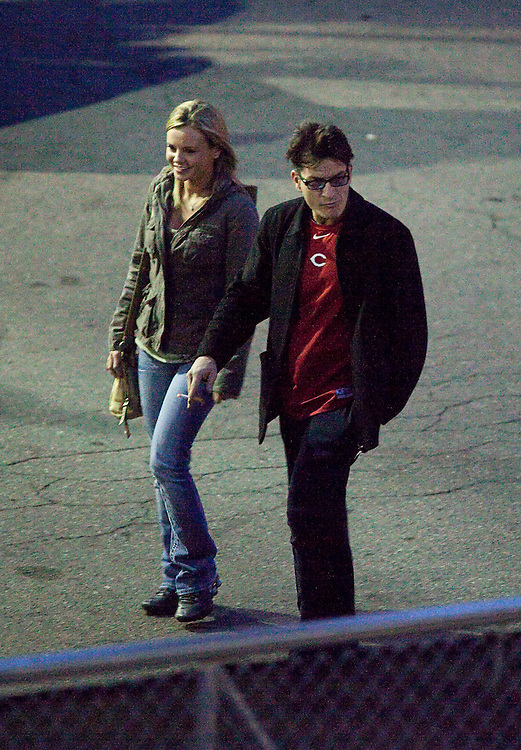 Charlie Sheen walks with an unidentified woman to the stage door at the Fox Theatre in Detroit, Michigan April 2, 2011 to start his show Violent Torpedo of Truth/Defeat is Not an Option.<br /> AFP/GEOFF ROBINS/STR