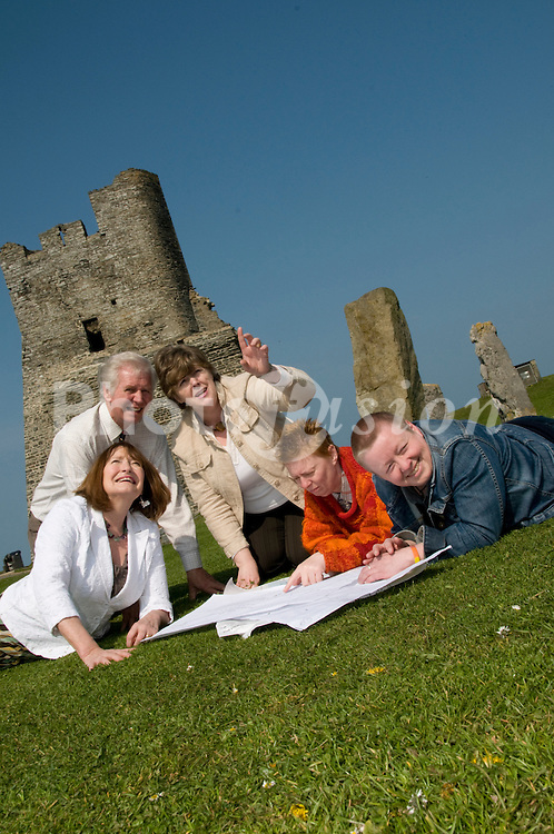 Adult education and lifelong learning at Aberystwyth University - group of students studying local history in the castle