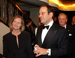 MR & MRS RICHARD DESMOND owner of The Express at The Caron Keating Foundation Dinner in honour of the late TV presenter who died in April 2004, held at The Savoy, London on 4th October 2004.<br />