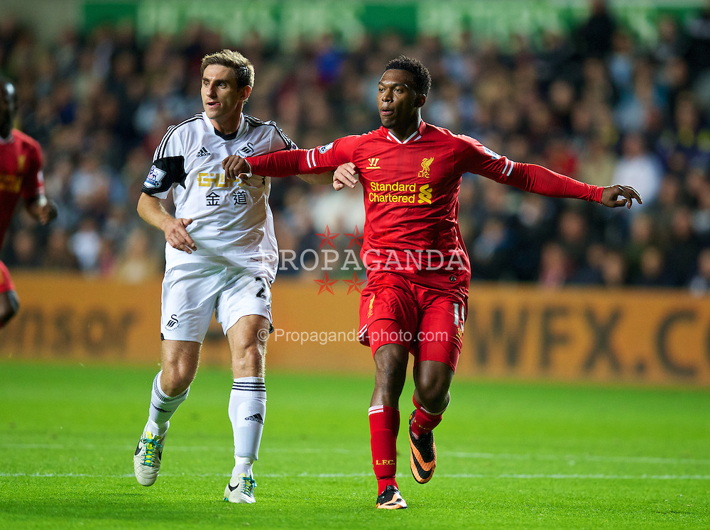 SWANSEA, WALES - Monday, September 16, 2013: Liverpool's Daniel Sturridge in action against Swansea City during the Premiership match at the Liberty Stadium. (Pic by David Rawcliffe/Propaganda)