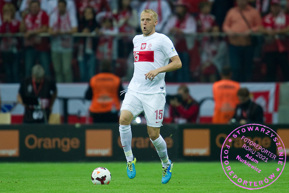 Poland's Kamil Glik controls the ball during the 2014 World Cup Qualifying Group H football match between Poland and Montenegro at National Stadium in Warsaw on September 06, 2013.<br /> <br /> Poland, Warsaw, September 06, 2013<br /> <br /> Picture also available in RAW (NEF) or TIFF format on special request.<br /> <br /> For editorial use only. Any commercial or promotional use requires permission.<br /> <br /> Mandatory credit:<br /> Photo by &copy; Adam Nurkiewicz / Mediasport