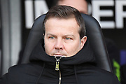 Forest Green manager Mark Cooper  wraps up against the cold during the EFL Sky Bet League 2 match between Northampton Town and Forest Green Rovers at the PTS Academy Stadium, Northampton, England on 14 December 2019.