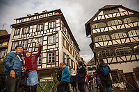 Strasbourg, France - November 16, 2014: A group of tourists stop for photos in Petite-France in Strasbourg. The historic neighborhood, which is known for its medieval half-timbered houses, lies on Grande Île, where the river Ill splits into a number of canals. CREDIT: Chris Carmichael for the New York Times